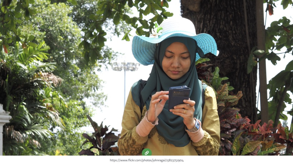 a woman using smartphone